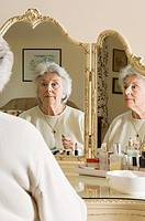 Senior woman at dressing table