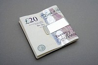 Twenty pound notes in money clip