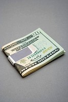 Twenty dollar bills in money clip