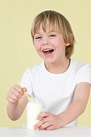 Boy with yoghurt (thumbnail)