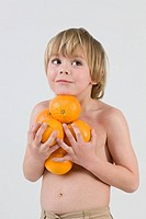 Boy holding oranges
