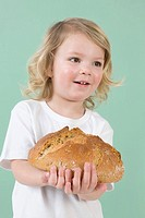 Girl with loaf of bread