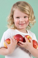 Girl holding apples