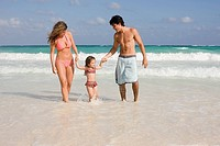 A family walking in the sea