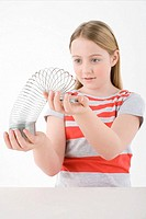 Girl holding metal coil