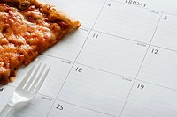 A pizza slice and a calendar
