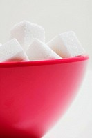 A bowl of sugar cubes
