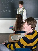 Teenage boy in class (thumbnail)