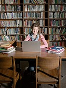 Girl working in library