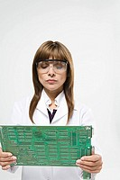 Scientist with circuit board