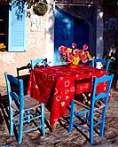 Table and blue chairs _ southern terrace