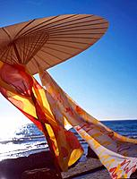 Parasol with colourful scarves