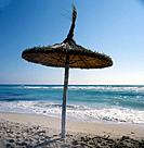 Parasol made of straw on the beach