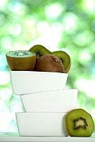 Kiwi fruits in a stack of white bowls