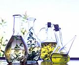 Oil bottles with herbs