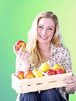 Blonde woman with a fruit basket