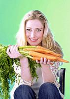 Blonde woman with carrots