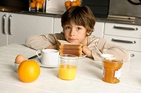 Portrait of a boy having breakfast
