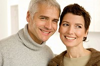 Close_up of a mature man and a mid adult woman smiling