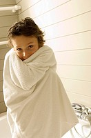 Portrait of a boy wrapped in a towel