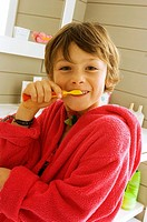 Portrait of a boy brushing his teeth