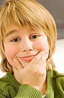 Close_up of a boy making a face