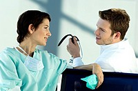 Female doctor discussing with a male doctor