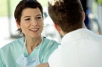 Close_up of a female doctor discussing with a male doctor