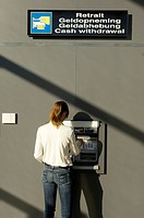 Rear view of a businesswoman using an ATM