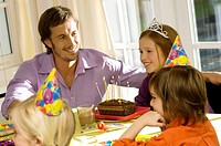 Mid adult man celebration his daughter's birthday