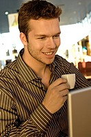 Close_up of a businessman holding a tea cup and smiling