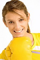 Portrait of a female boxer wearing a boxing glove and smiling (thumbnail)