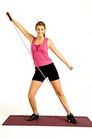 Portrait of a young woman exercising with a resistance band
