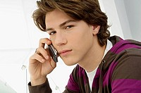 Portrait of a teenage boy talking on a mobile phone