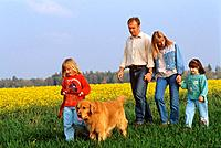 family with Golden Retriever _ walk