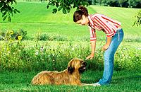 young woman with Briard _ lying