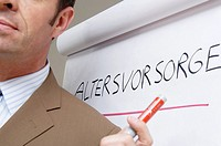 Close_up of businessman giving presentation in seminar