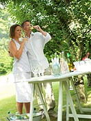 Couple drinking wine in garden
