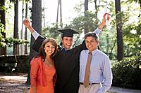 Happy parents with excited graduate