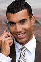 Smiling businessman on cell phone
