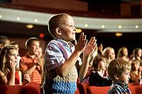 Boy giving standing ovation