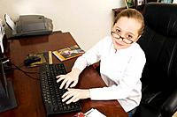 Girl typing on computer keyboard
