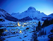 Aerial view of village on snow_covered landscape lit up at night, Lech am Arlberg, Vorarlberg, Austria