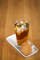 A glass with Ice Tea and cakes