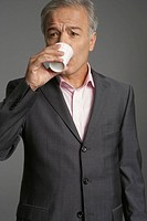 Businessman drinking a cup of water