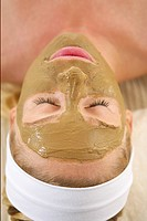 Young woman with facial mask (thumbnail)