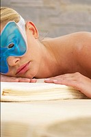 Young woman wearing an eye mask relaxing