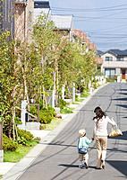 Mother and son walking around the residential district