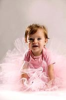 Studio portrait of young girl 2_3 in pink tutu