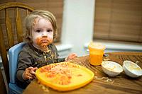 Portrait of girl 18_23 months with spaghetti sauce on face